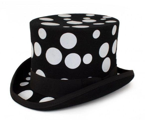 Zwarte cilinder hoed met witte bollen
